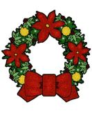 A wreath with red and yellow flowers.