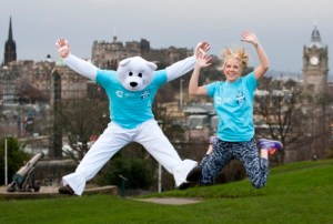 Cancer Survivor, Heather Duff promoting Cancer Research's Snowflake 10k in Edinburgh
