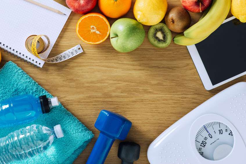 Fueled by Launch fitness and health items like fruit, scales, weights, and tape measure for health and online courses