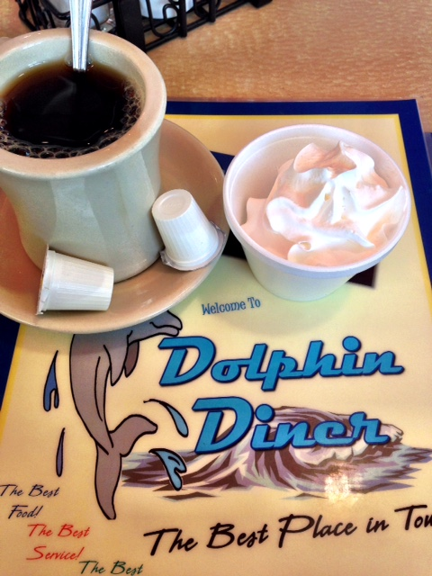 Bowl of whipped cream and coffee