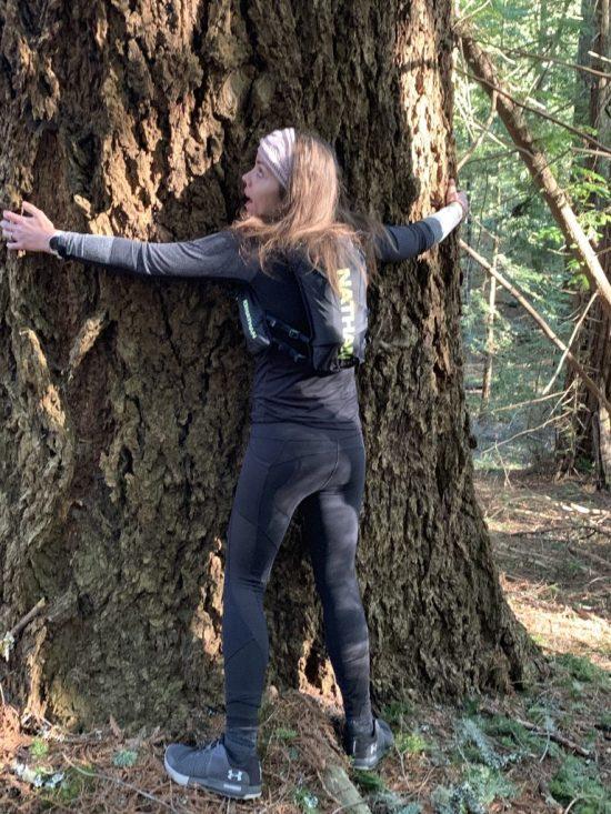 me hugging redwood tree