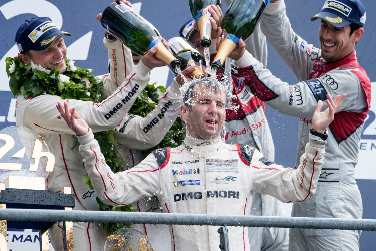 Romain Dumas (FRA) celebrates winning the 2016 24 Hours of Le Mans for Porsche.