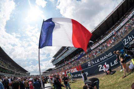 The French Tricolor is proudly displayed on the grid before the start of the 2016 24 Hours of Le Mans