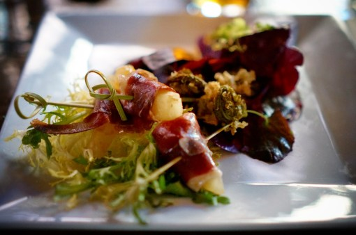 Duck Prosciutto wrapped Pepino Melon, Tempura fried Fiddlehead Salad