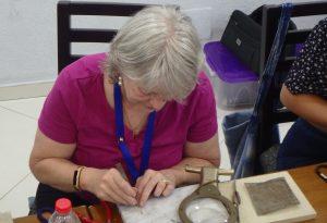 Woman working on filigree art project