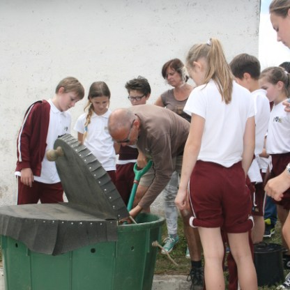Students learning about our worm composting system