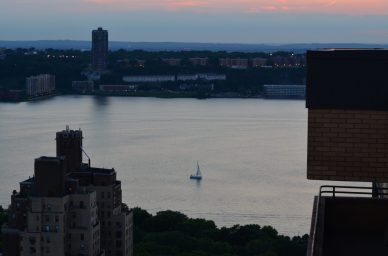 Solo Sailboat In The Hudson River