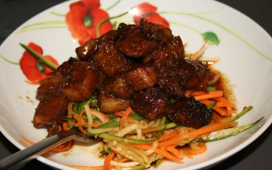 Sticky pork belly with green papaya and carrot salad