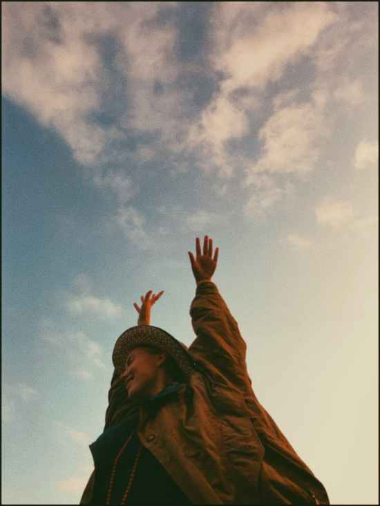 anonymous content woman against cloudy sky