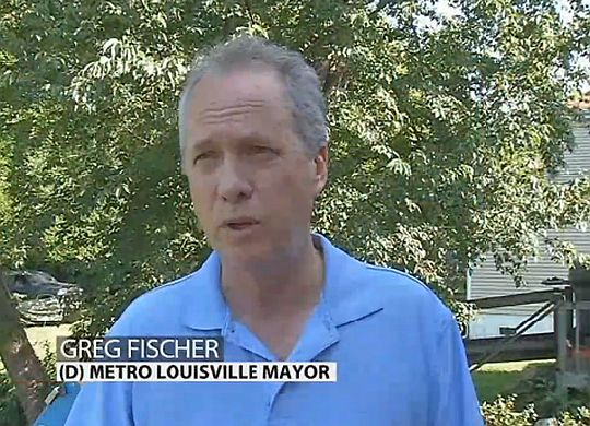 Louisville Mayor Greg Fischer picks up a hammer to join Fuller Center project