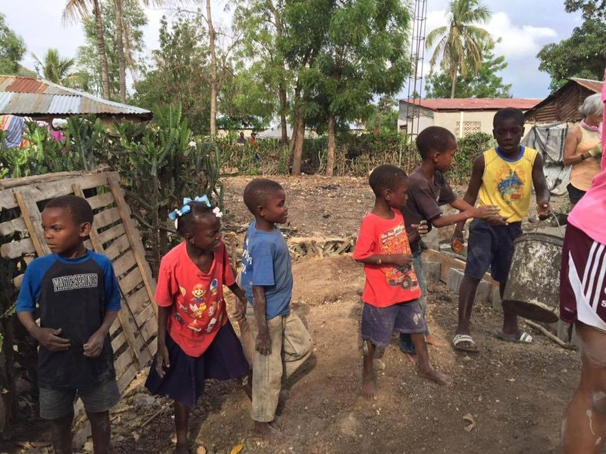 Haitian children love to help build Fuller Center homes.
