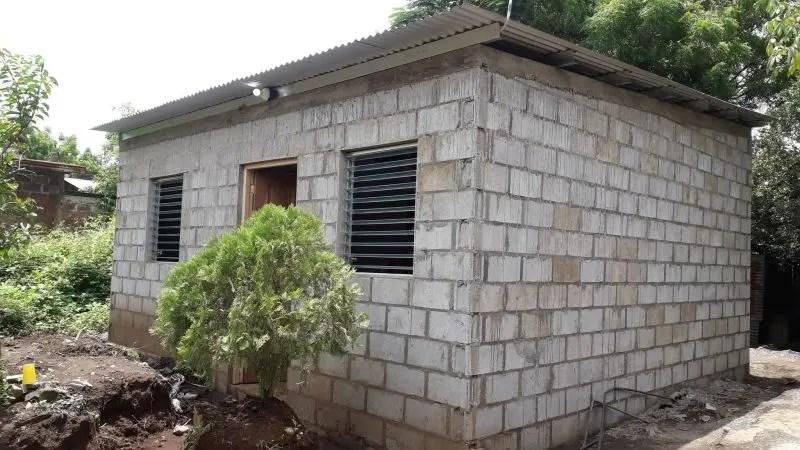 montielo frente casa 2 lateral