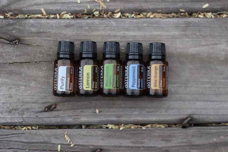 bottles of DoTERRA oils: Purify, Lemon, Melaleuca, Peppermint, Wild Orange