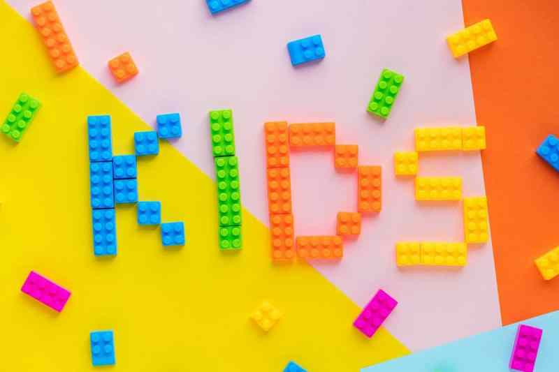 """kids"" spelled out in colored lego pieces"