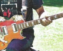 "Tom Morello, ""This guitar was an awful Budweiser promotional guitar"" – Gibson Les Paul – Ace Frehley Pickups"