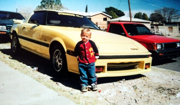 Yellow Mazda Rx7 and my son.