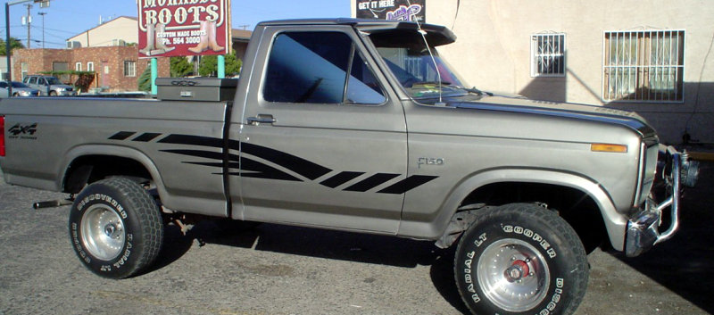 Silver Ford F-150 pickup with matte black side graphics