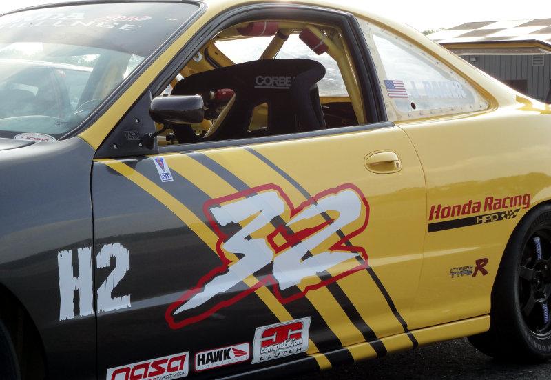 Racing car graphics H2 32 Racing Red, yellow, black.