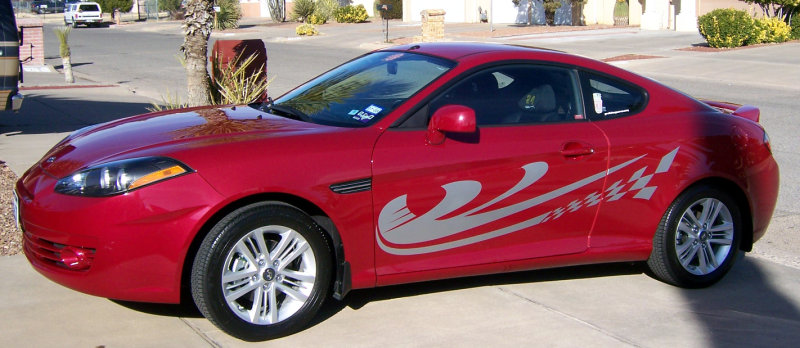 Clean red sports car with silver vinyl graphics