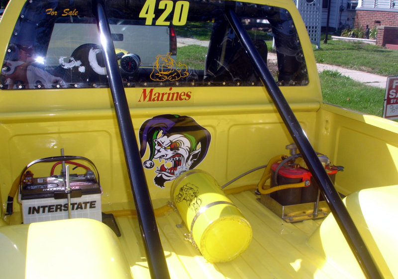 Yellow race truck with evil clown decal