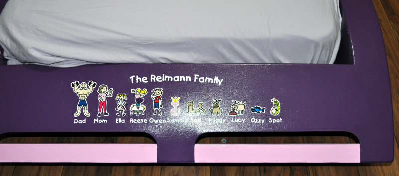 Family sticker applied to purple race-car bed