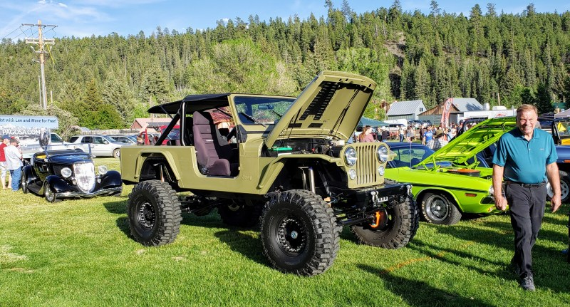 drab gree old jeep lifted