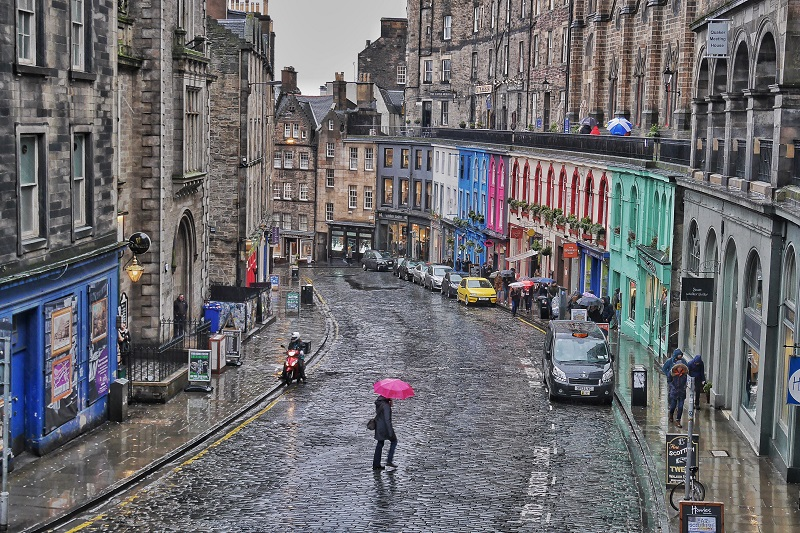Woman with a pink umbrella crosses Bow/Victoria Street in Edinburgh. This is probably one of my all-time favourite shots I've taken. I waited for someone with a colourful umbrella for over 5 minutes in the blowing wind and rain and snow. So happy with the result.