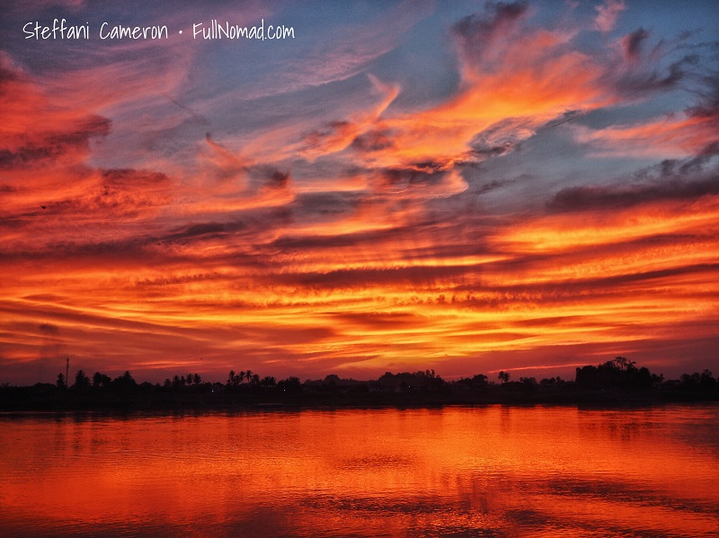 Beautiful fiery sunset over the river
