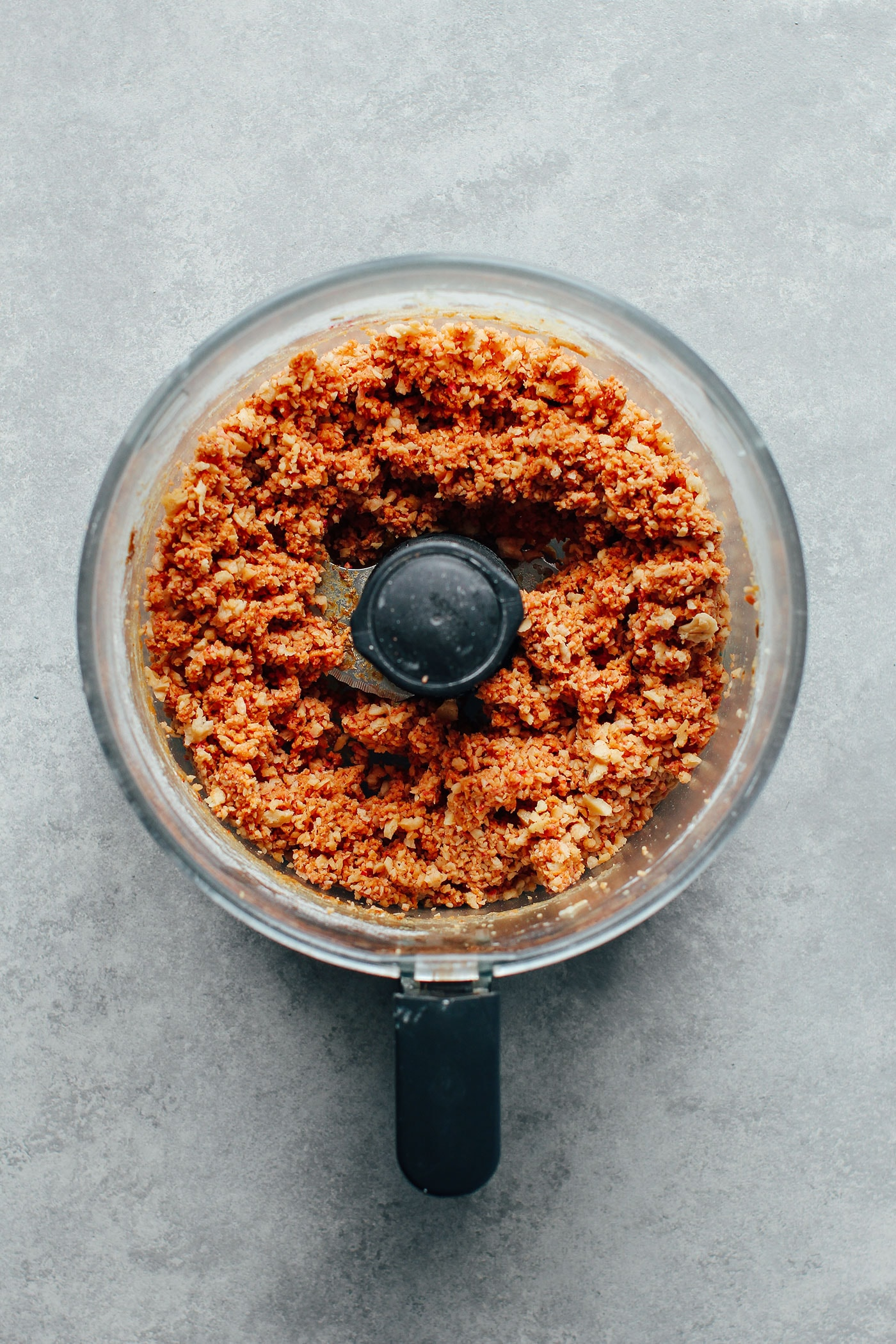 Textured vegetable protein in food processor to make high protein vegan burgers.