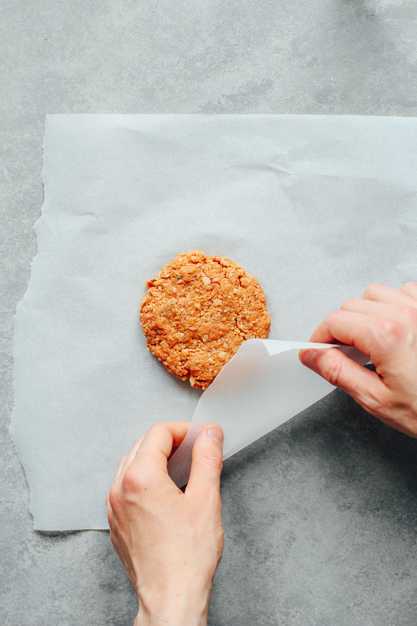 Wrapping high-protein vegan burgers in parchment paper.