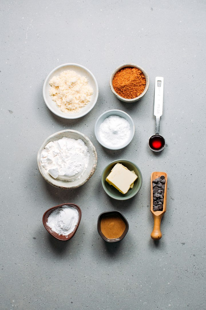 Ingredients for cookies, almond flour, chocolate chips, coconut sugar, vegan butter, and potato starch.
