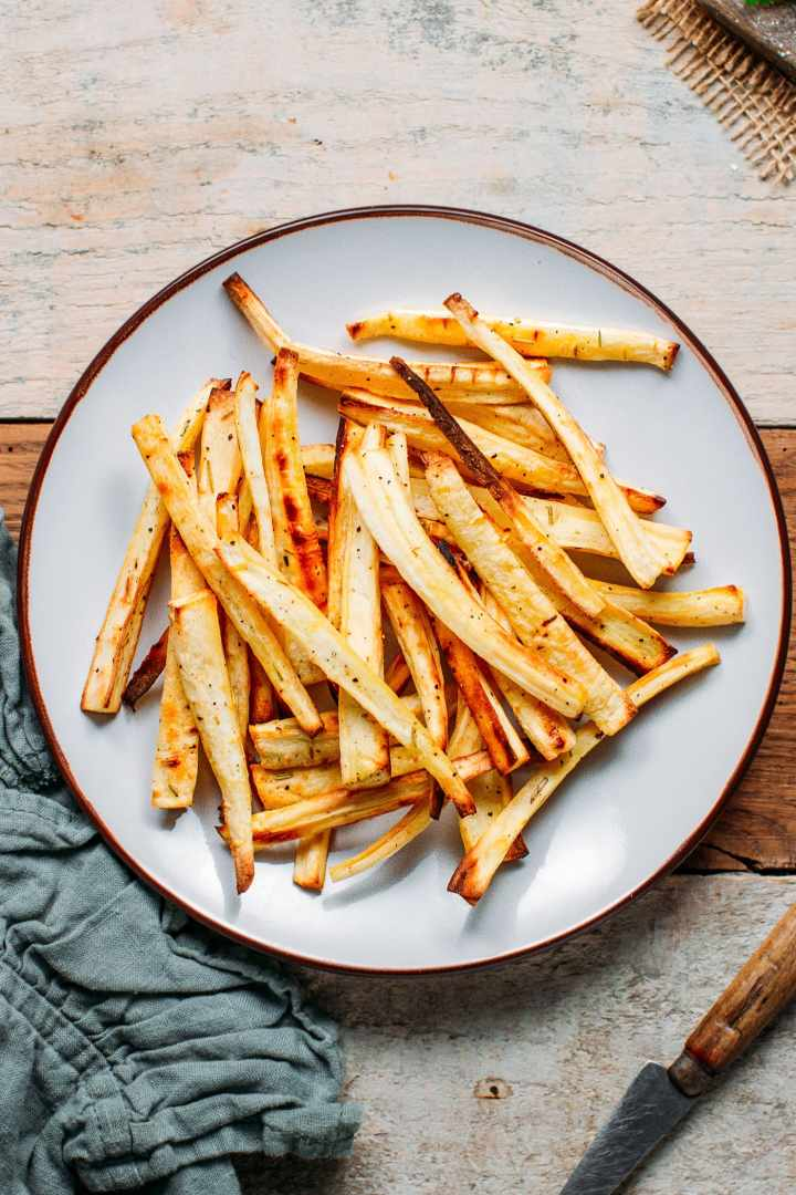 Baked Parsnip Fries with rosemary and ground black pepper.