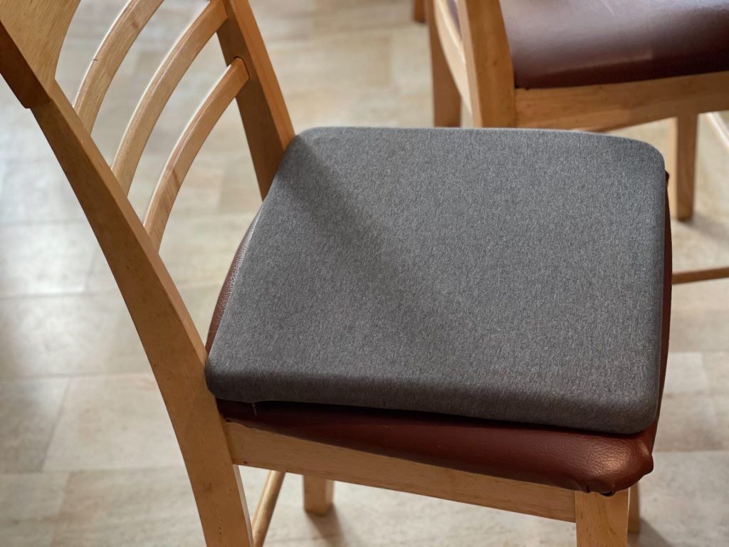 The cushion in action on one of the offending chairs.