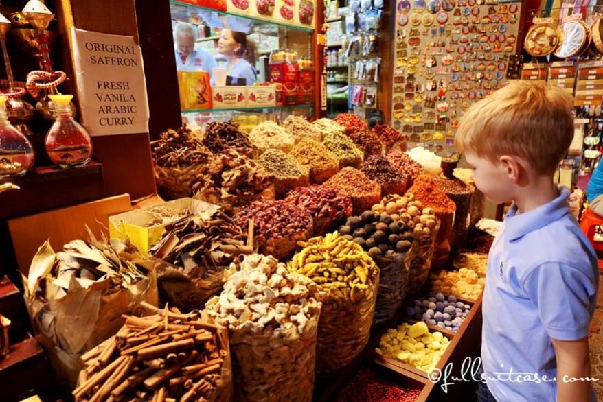 Boy tourist at the spice stand in Dubai Spice Souk in Deira