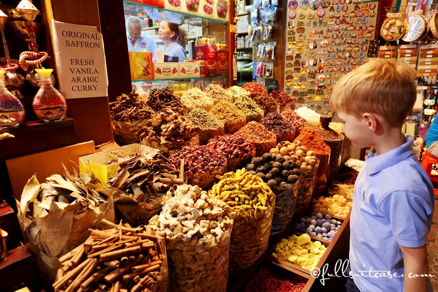 Boy tourist at the spice stand in Dubai Spice Souk in Deira