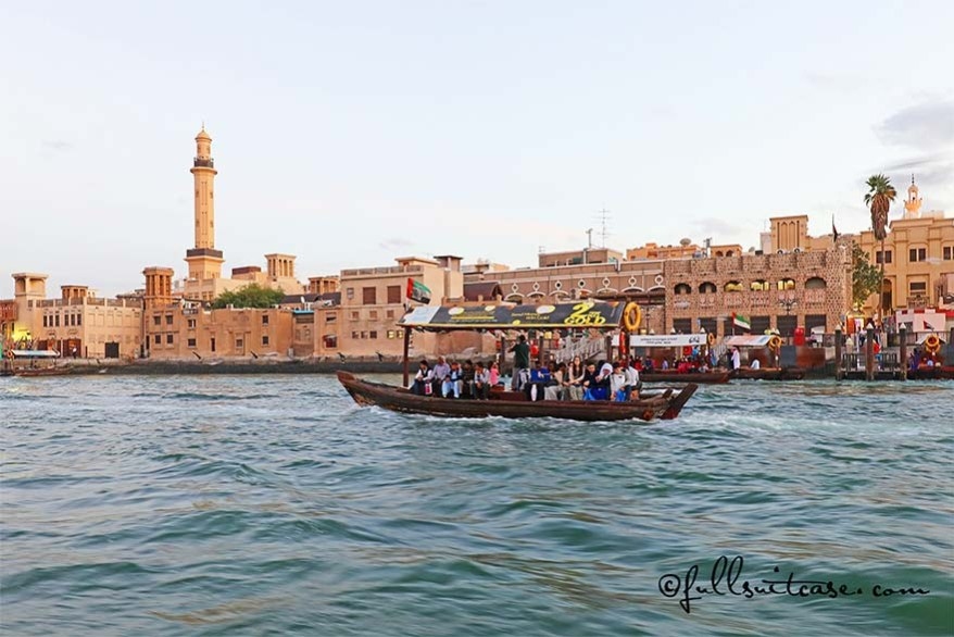 Dubai downtown and traditional water taxi Abra as seen from the Dubai Creek