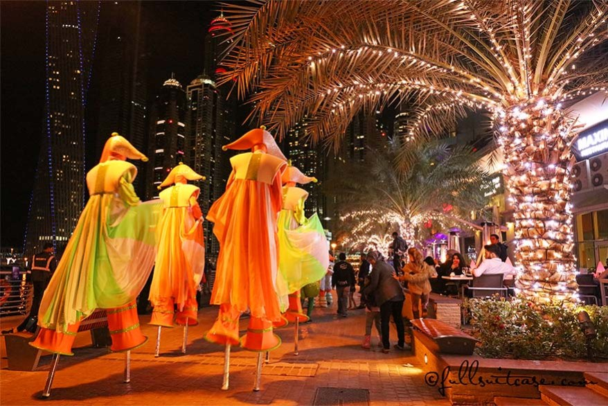 Dubai Marina Festive Parade with street performers walking on stilts