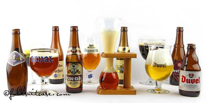 Variety of Belgian beers with matching glasses