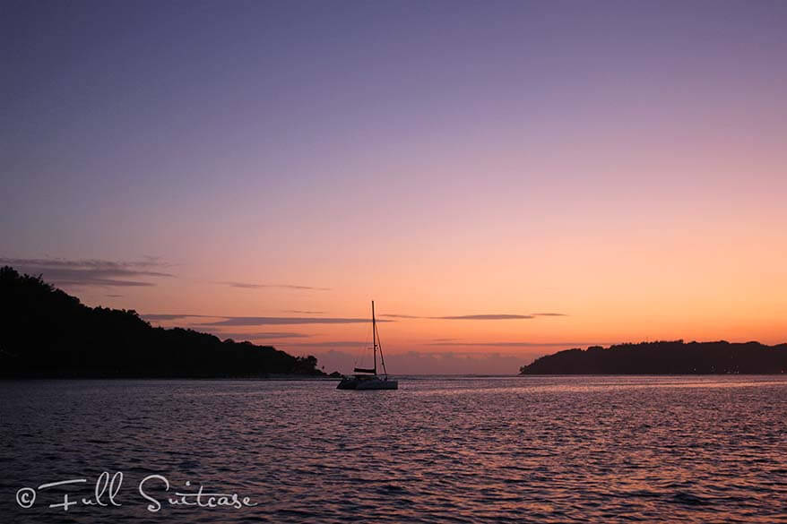 Sailing in the Seychelles at sunset in the evening
