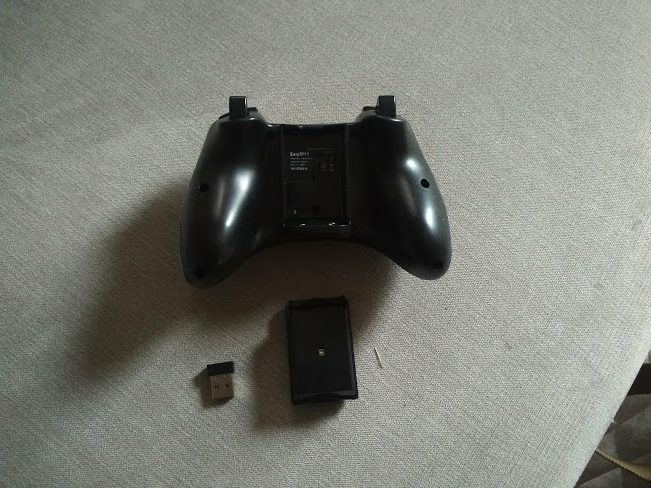 EasySMX Wireless Controller out of box showing an Xbox 360 controller with wireless USB adapter and battery pack