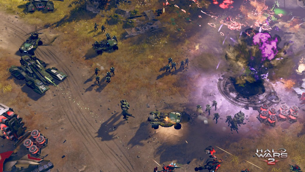 Halo Wars 2 gameplay showing a massive attack on a covenant base