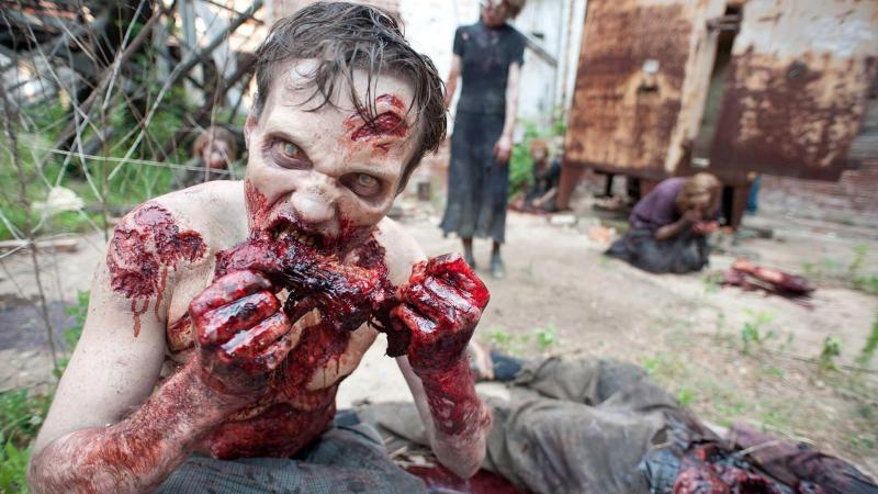 Zombie eating human flesh