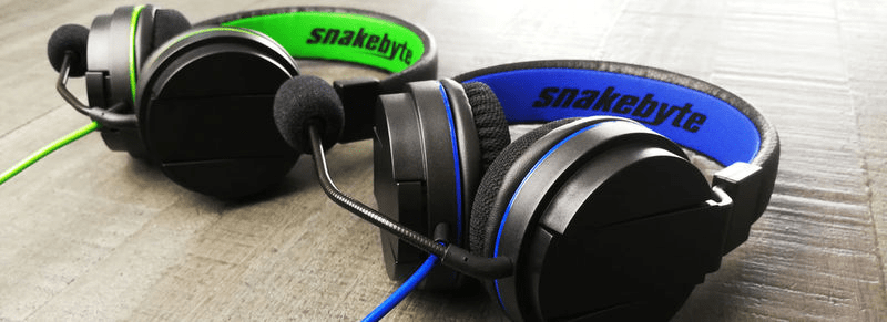 The Snakebyte Headset X in Green and Headset 4 in Blue resting side-by-side
