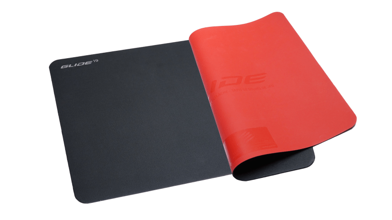 Two Mad Catz G.L.I.D.E.19 mouse mats, one lay flat, the other folded on top