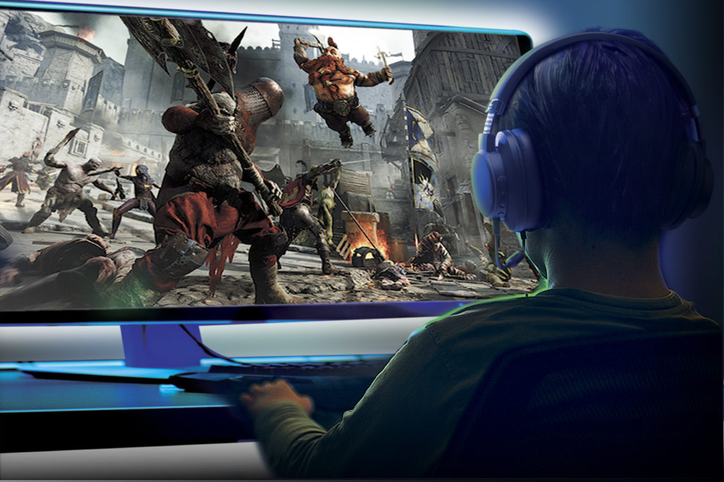 SXFI THEATER - Young boy playing games on a computer at home