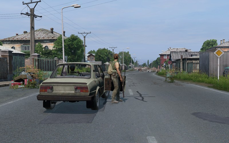 Gameplay screenshot of man getting out of car on Bohemia Interactive's DayZ