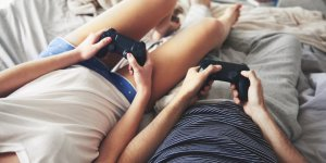 Gamer Couple with PlayStation controllers