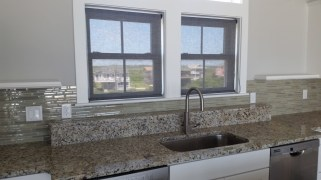 solar-shades-over-kitchen-sink