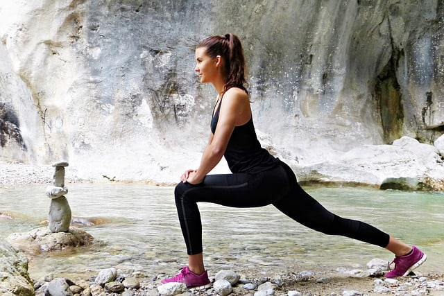 yoga pose outside by stream