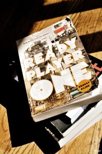 a stack of books with Ready Player One on top